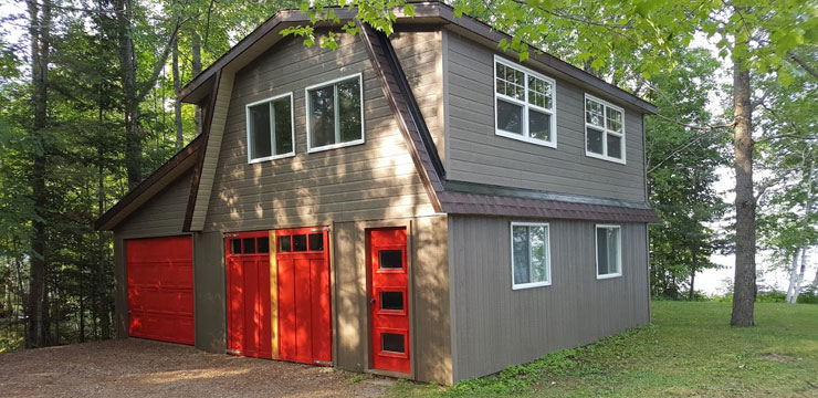 exterior photo of newly renovated waterfront garage and sleep bunky