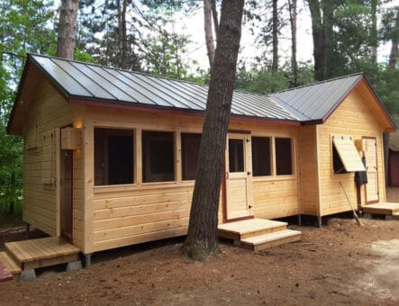 exterior photo of newly construction cabin, red pine camp, golden lake